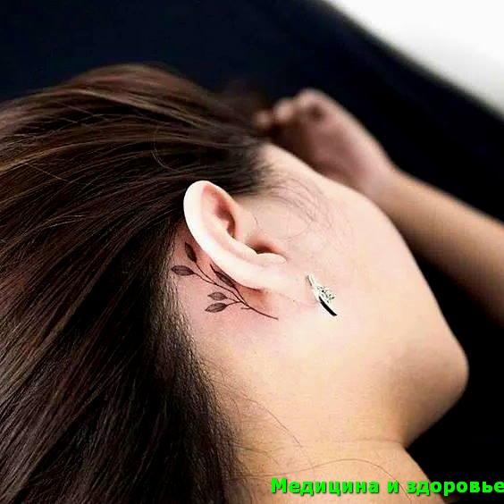 Татуировка за ухом с листьями